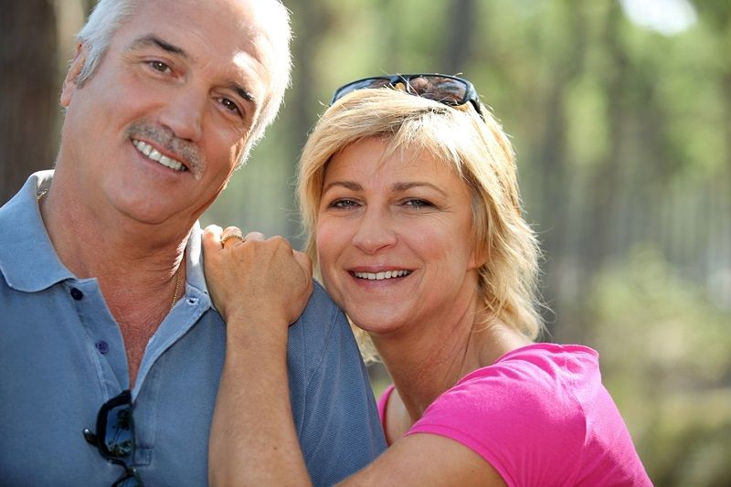 Senior Couple with Dental Implants Smiling